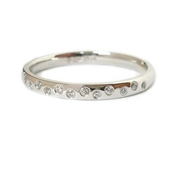 Platinum and diamond contemporary eternity/wedding ring