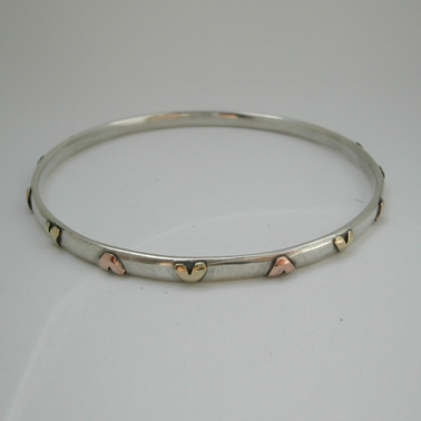 Bangle with brass and 9ct rose gold hearts