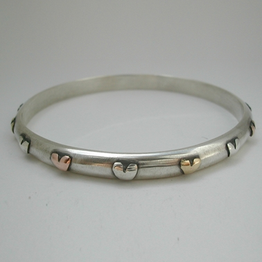Bangle with silver, brass and 9ct rose gold hearts