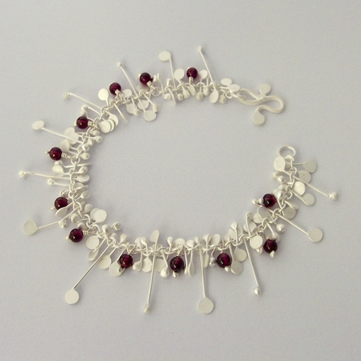Blossom wire bracelet with Garnet, satin by Fiona DeMarco