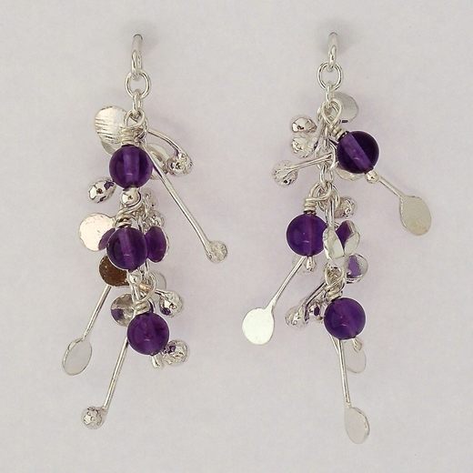 Blossom wire stud earrings with amethyst, polished by Fiona DeMarco