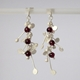 Blossom wire stud earrings with garnet, satin by Fiona DeMarco
