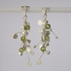 Blossom wire stud earrings with peridot, satin by Fiona DeMarco