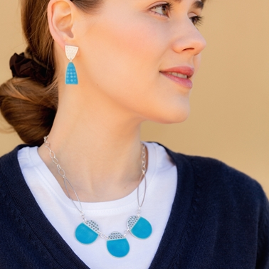 Buoy necklace & Leonora earrings on model