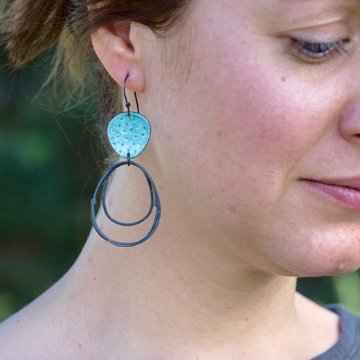Flotsam earrings in turquoise on model