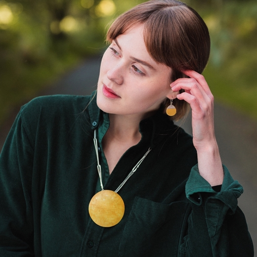 Island earrings and statement pendant on model
