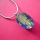 blue oval pendant with gold leaf layer
