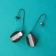 black and aluminium leaf oval drop earrings