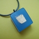 dark blue and gold leaf square pendant