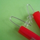 red oblong earrings detail