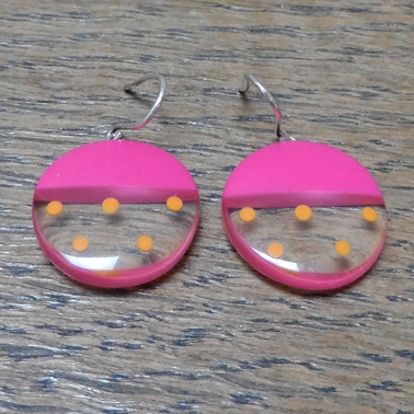 cerise round resin earrings with orange spots