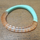 Turquoise wangle bangle with orange stripes
