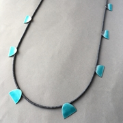 Deep turquoise eight shape necklace