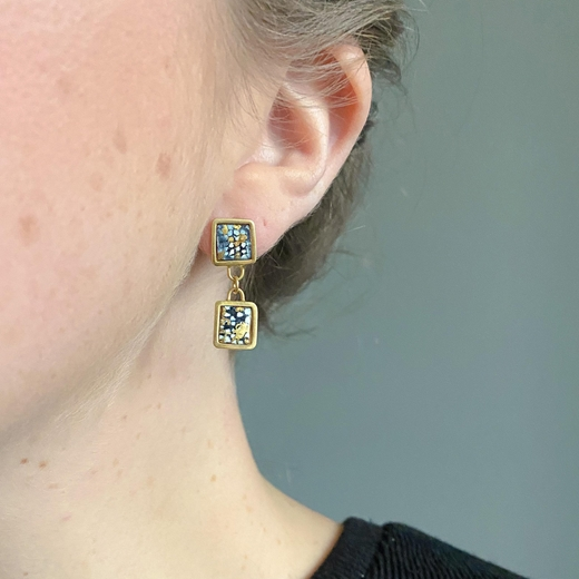 Gold plated blue and gold square framed double drop earrings worn