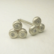 Silver pebble earrings with diamonds
