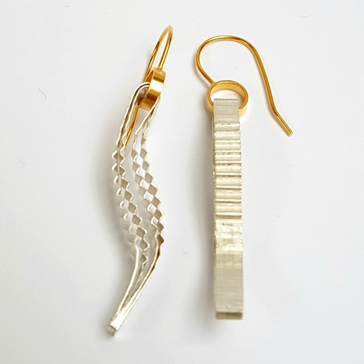 Strata Earring, silver with gold hook, side view