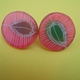 pink and green round earrings
