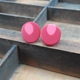 pink and red round studs