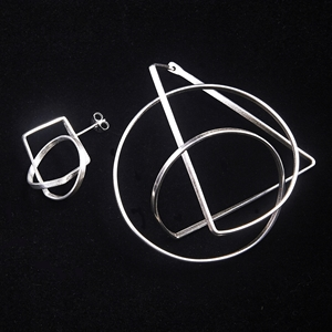 Orbit mismatch earrings 1