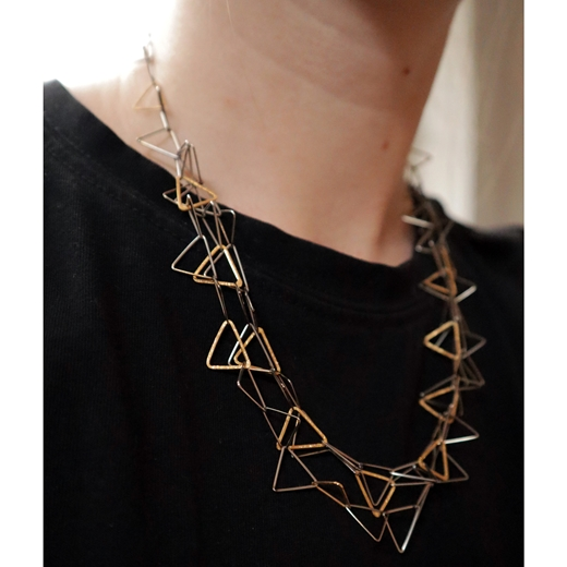 Fankle with gold plated triangles worn