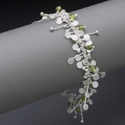 Blossom wire bracelet with peridot, satin