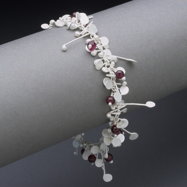 Blossom wire bracelet with garnet, satin