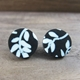 Floral studs black and cream
