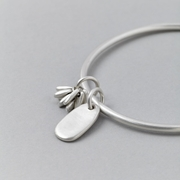 Tag and pompom bangle