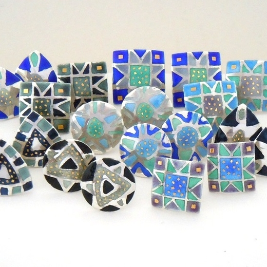 lection of etched and enamelled earrings