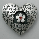 Heart brooch with spinning daisy