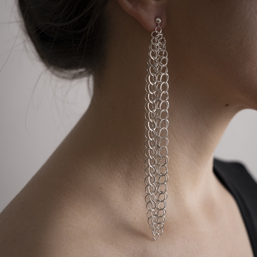 Holme earrings on ear