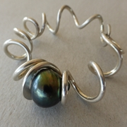 Spiral silver bangle with Tahitian pearl