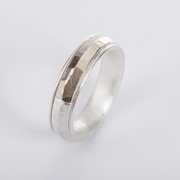 Ring within a ring, silver and white gold