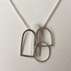 Three wire and one textured shape pendant