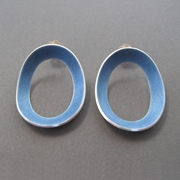 Pale blue oval domed studs