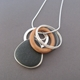 Pebble pendant with wooden hoop