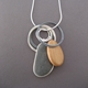 Pebble pendant with wooden pebble