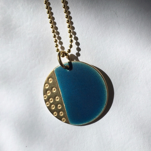 gold and blue pendant