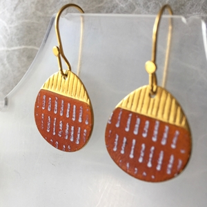 Gold and orange earrings