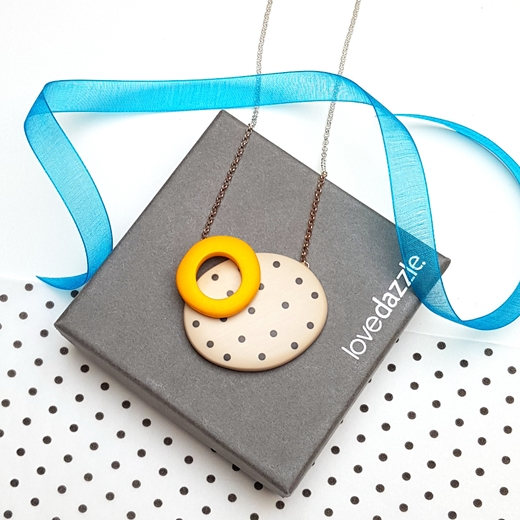 Gift wrapped double oval pendant - nude with black dots and yellow hoop.