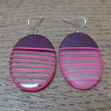 maroon oval resin earrings with mismatch cerise stripes