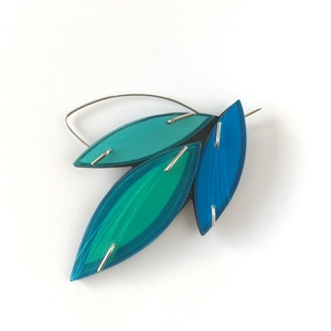 blue and green brooch