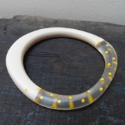 nude bangle with yellow dots