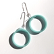 Large loop earrings in blue.