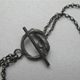 long string neckpiece on oxidised chain