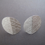 Silver folded oval earrings