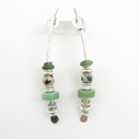 Large green arc earrings