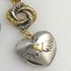 Mini loveknot and winged heart locket