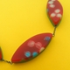 red patterned leaf necklace detail