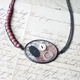 Necklace with oval collage and rhodonite beads